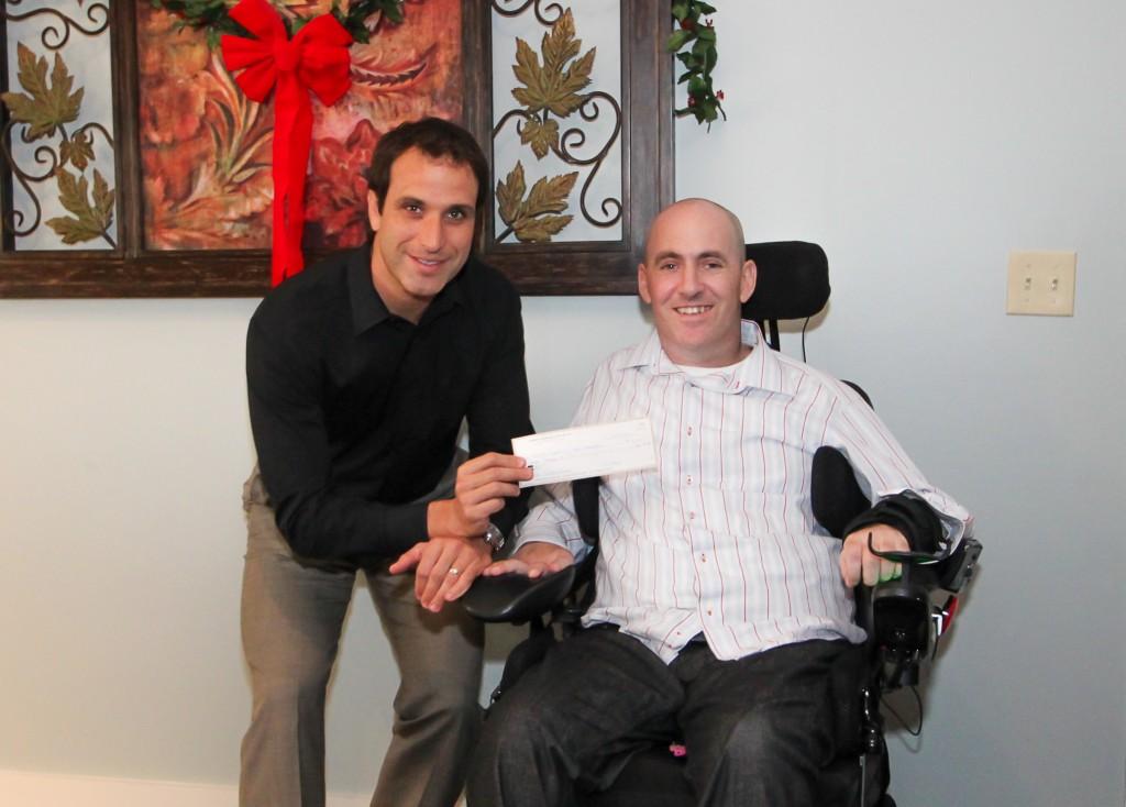 Hammer Down Multisport presents a check to Danny Margagliano of Donations 4 Danny