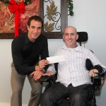 Hammer Down Multisport presents a check to Danny Margagliano of Donations 4 Danny